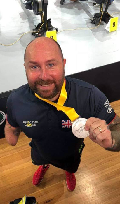 Dave proudly shows off his silver medals